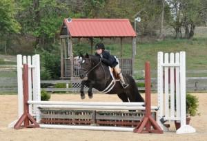 Emma Hess competing on her medium pony, Blackberry Storm