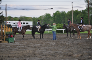 Horseback Riding Lessons - Terri Young teaching a group of young riders